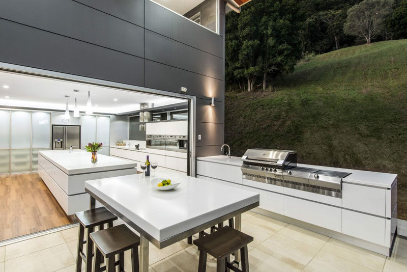 This Modern Outdoor Kitchen Appears As An Extension Of The Interior Kitchen  With The Same White