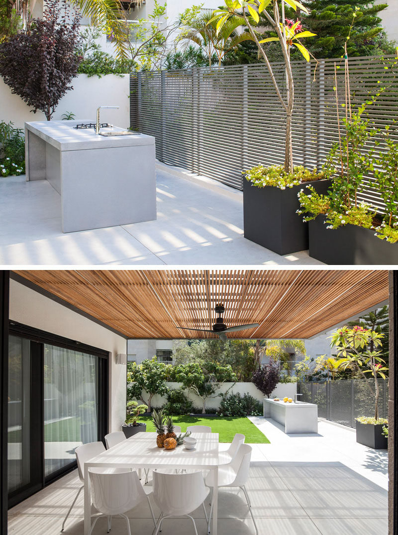 This modern outdoor kitchen has a simple work area, a cooktop and a place to sit and enjoy a meal.