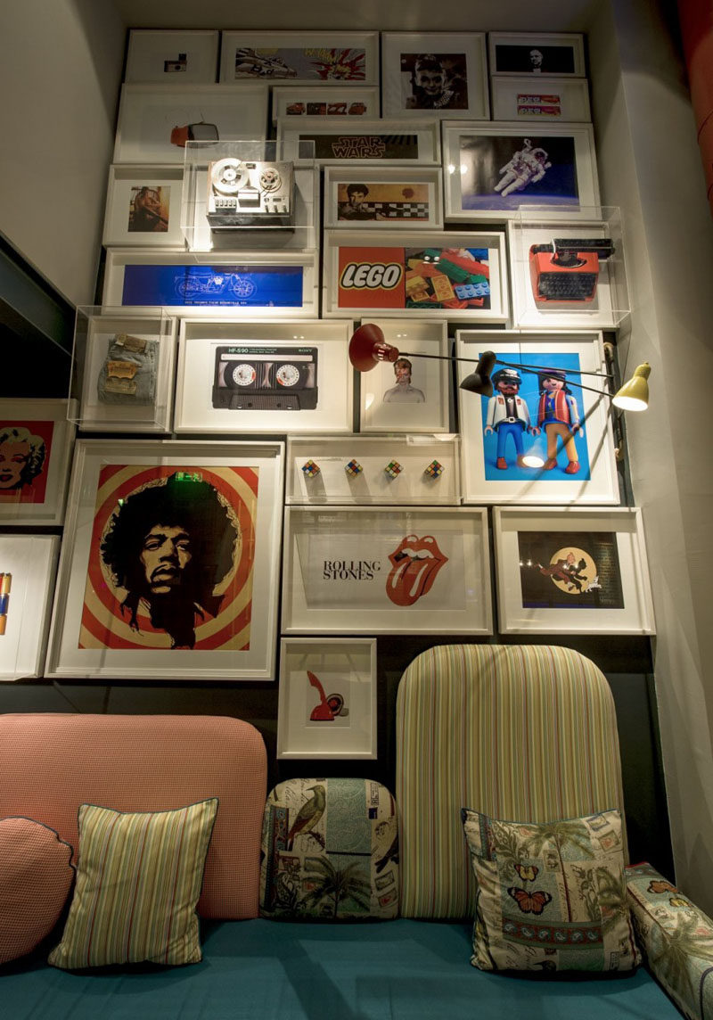 The gallery wall in this cafe combines prints with objects framed in glass boxes to add more dimension to the wall, and allow for more than just art to be included.