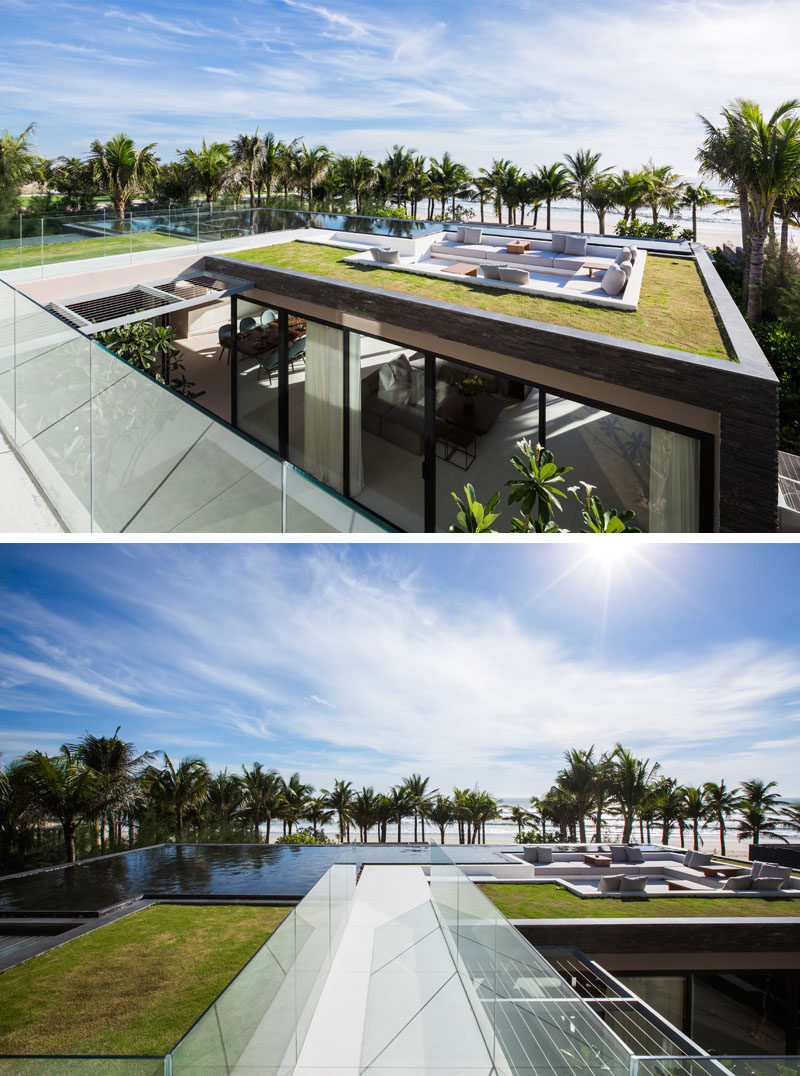 The sunken lounge space on the roof of this beachside villa has built-in couches that warp around the sides, and a water feature and green roof surround the area.