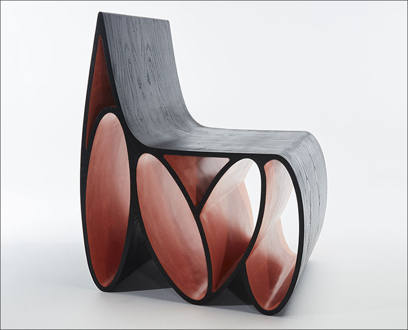 Jason Mizrahi has designed the Loop Chair, a sculptural wood chair made from ash with a lacquered ebony finished veneer.