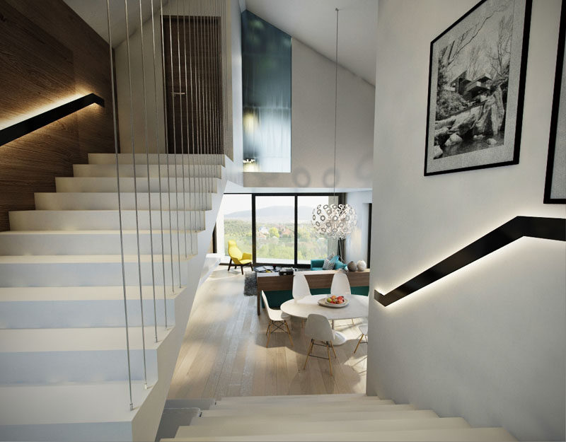 These white stairs feature backlit handrails that make sure that you can see where you are going, even when it's dark.