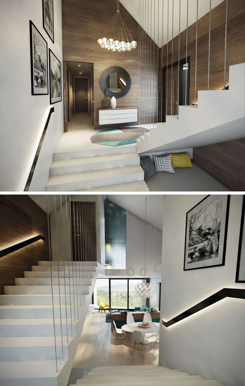 These modern white stairs surrounded by wood walls feature backlit handrails that make sure that you can see where you are going, even when it's dark.