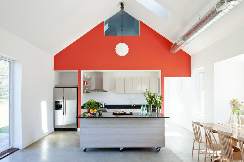 This movable kitchen island in this bright and modern kitchen, can either be left in the middle of the kitchen or pushed off to the side to make room a large gathering or a family dinner.