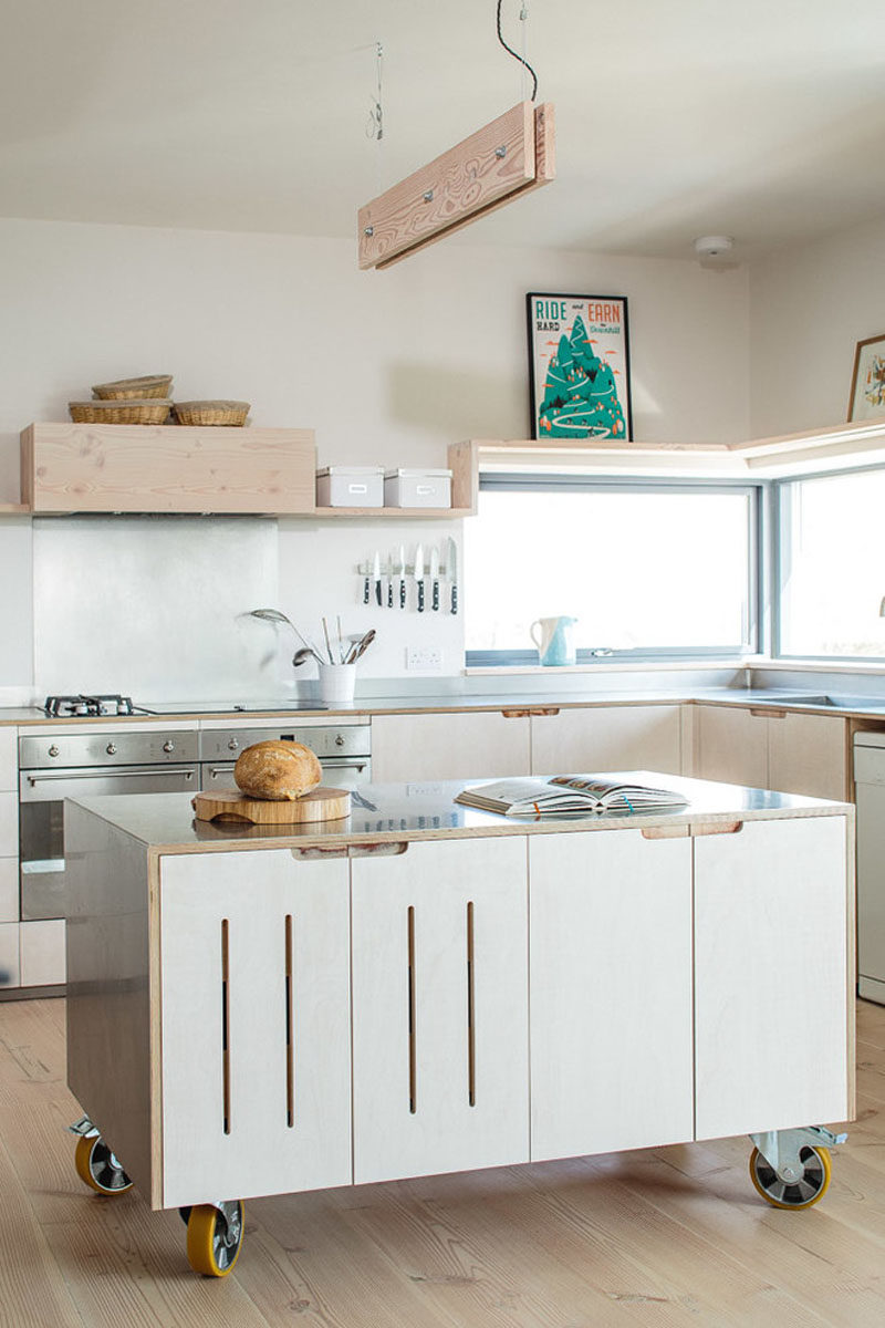 A Stainless Steel Surface And Large Industrial Wheels On The Bottom Of This Simple Movable Kitchen Island Give It An Industrial Look While Still Keeping The