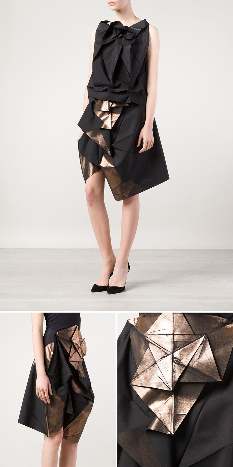 The fabric of this skirt has been folded and pressed to create distinct lines that are accentuated by the metallic finish on parts of the piece.