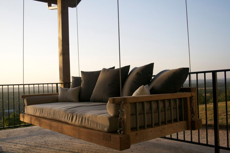 Hang up this wood outdoor swing bed and curl up with a book or a blanket for a cozy, relaxing retreat.