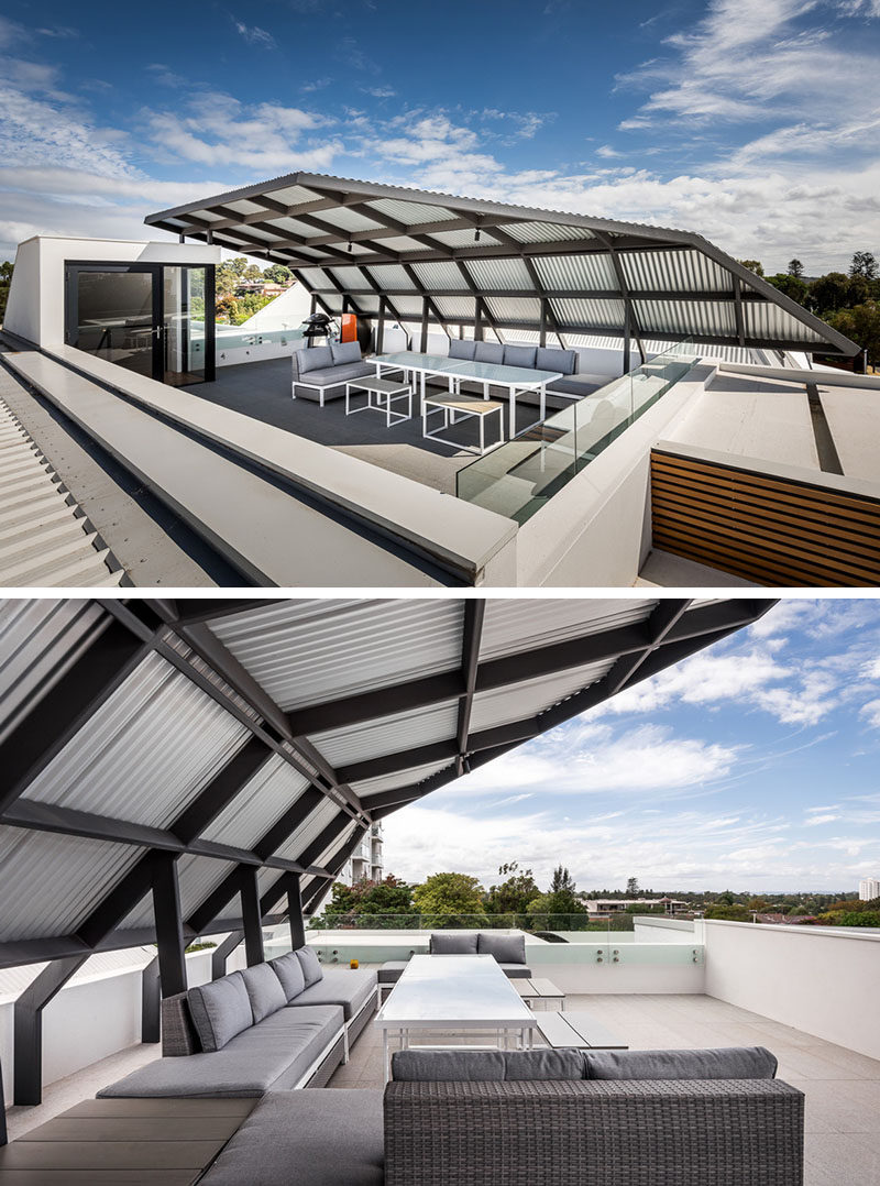 This partially covered rooftop deck takes advantage of the city views and is large enough to entertain a group of friends or family.
