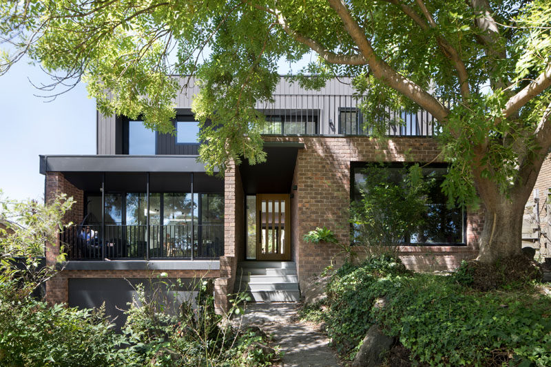 Inbetween Architecture Have Designed The Modern Renovation Of A 1970 S Double Y Brown Brick House Near
