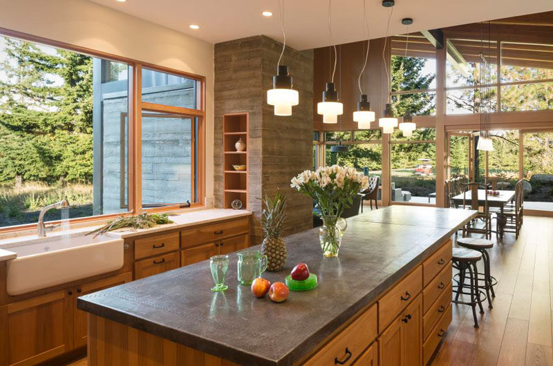 Inside this modern cabin, there's a rustic modern kitchen with a large farmhouse sink, while lots of work surfaces provide ample space for preparing family meals.