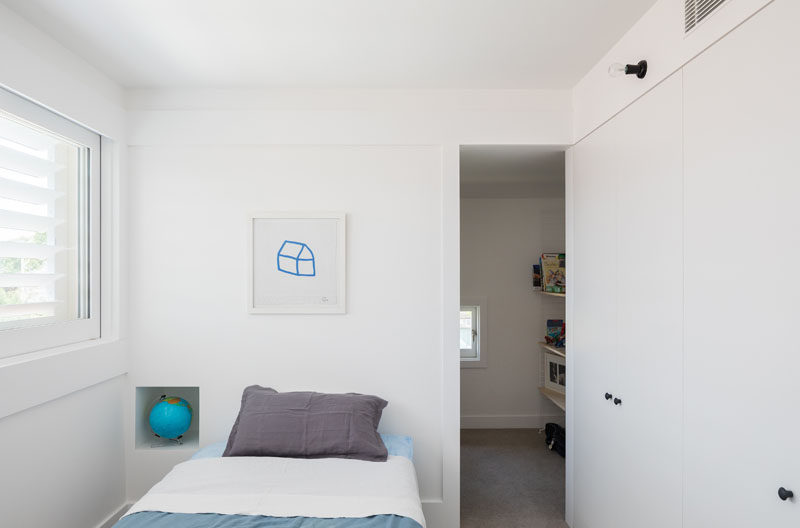 In this small bedroom there's lots of storage space in the form of large cabinets and a walk-in closet with more storage for clothes and toys.