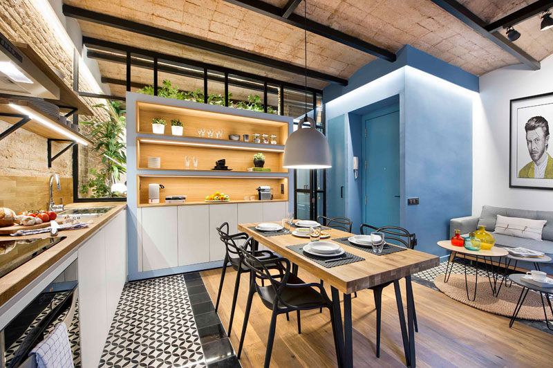 When redesigning this small 430 square foot (40m2) Barcelona apartment, Egue y Seta wanted to create a modern, connected space that retained some of the rustic charm of the building like the brick work, and included privacy options when desired.