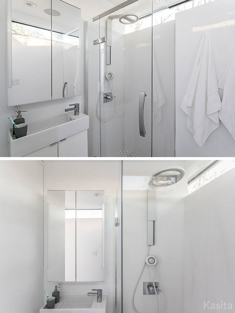 In this modern tiny home is a small bathroom with a shower, toilet and vanity.