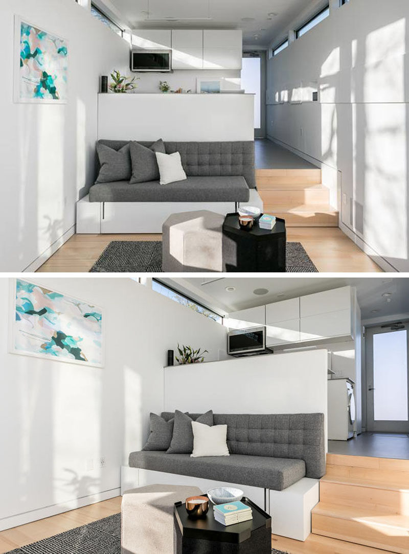 This tiny house has a ceiling height of just over 10 feet, and a custom designed couch fits the space perfectly and hides a bed.