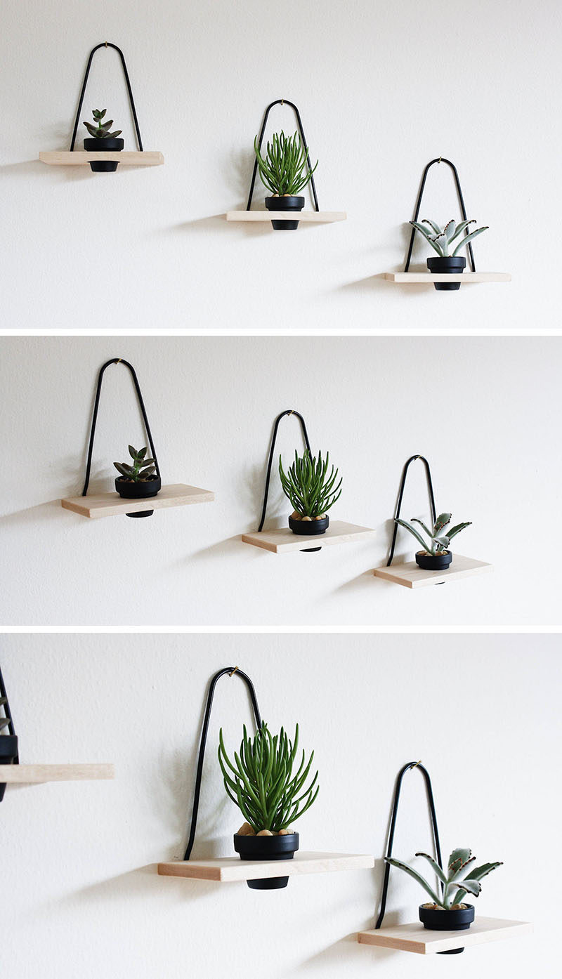 Add a minimalist touch to your interior and brighten it up with a few small plants potted in these wood and black metal mini wall planters, that are hung with a single hook. #WallMountedPlanters #WallPlanters #Decor #HomeDecor #Plants #Gardening