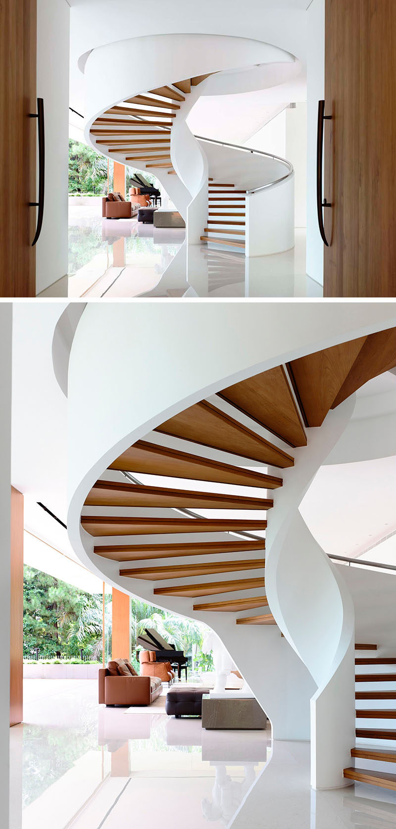 A grand spiral staircase created by floating wood treads between the two white sides rises up into the next floor and welcomes people as they enter the home. #SpiralStairs #SpiralStaircase #ModernSpiralStairs