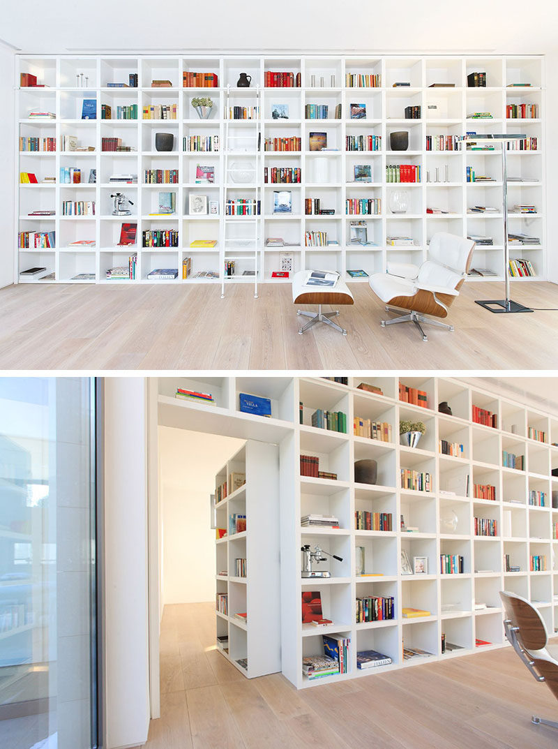 When Its Closed This Secret Door Blends In Completely With The Other Shelving Units Large Wall Of White Bookshelves