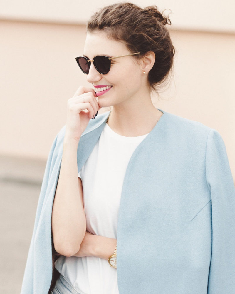 This light pastel blue minimalist womens spring coat, made from wool and a viscose lining, adds a soft touch of color to any outfit and keeps you warm on cooler days.
