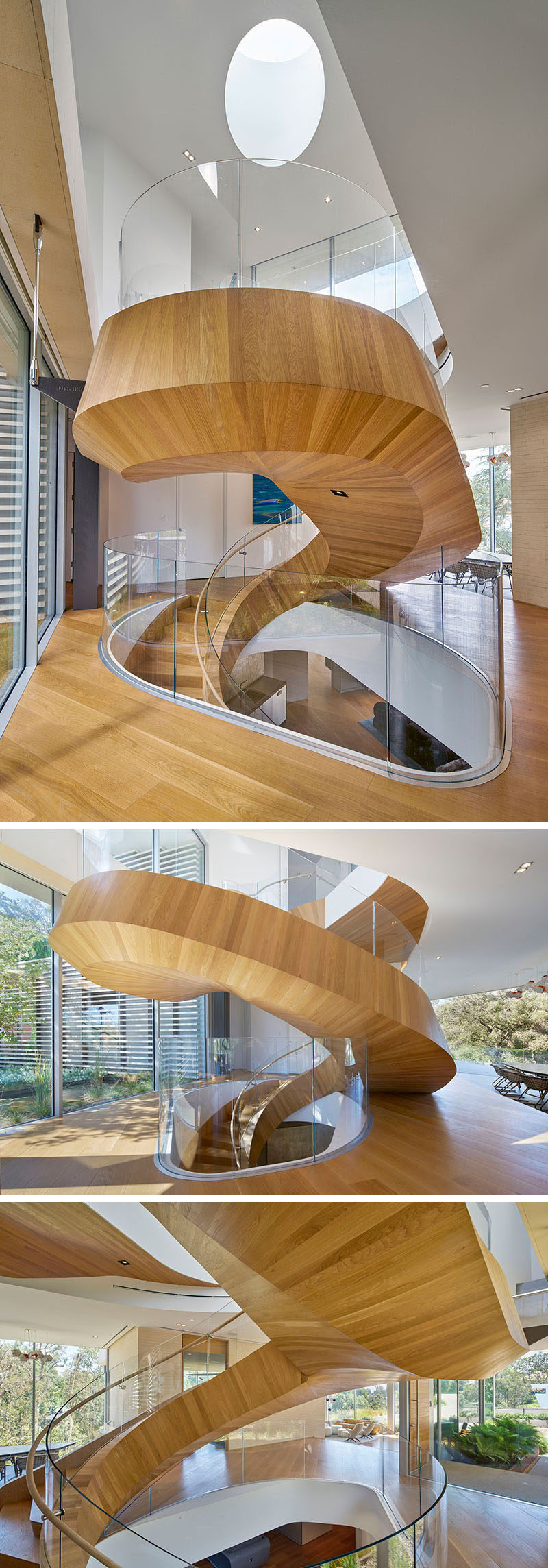 This large wood and spiral staircase not only connects various levels of the home but also divides the space and acts as a sculptural installation. #SpiralStairs #SpiralStaircase #ModernSpiralStairs #WoodSpiralStairs