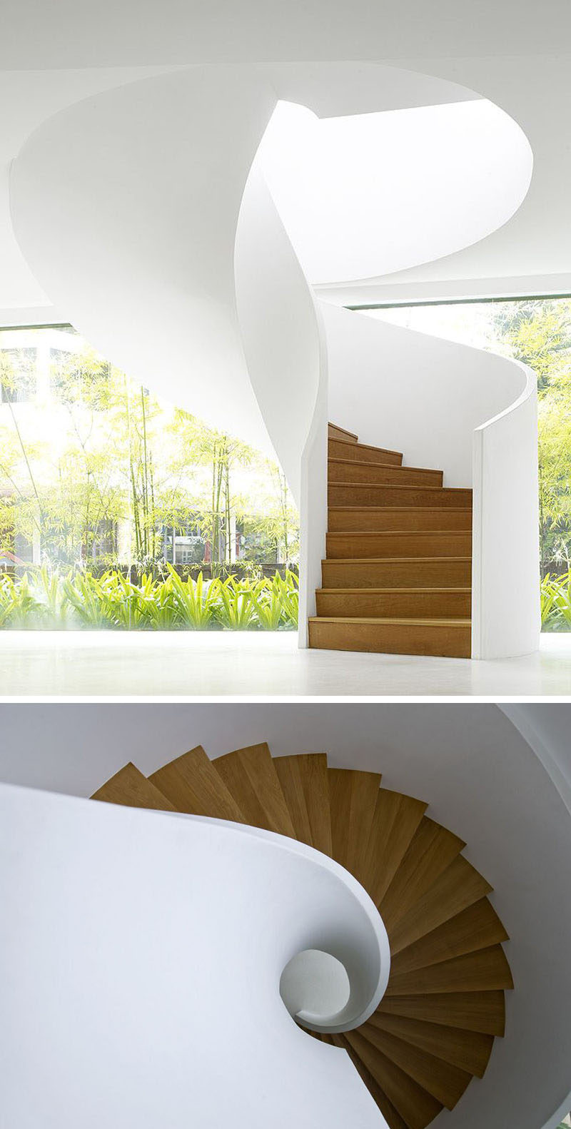 The smooth appearance of this modern white and wood spiral staircase makes it look like it could have simply twisted down from the ceiling. #SpiralStairs #SpiralStaircase #ModernSpiralStairs