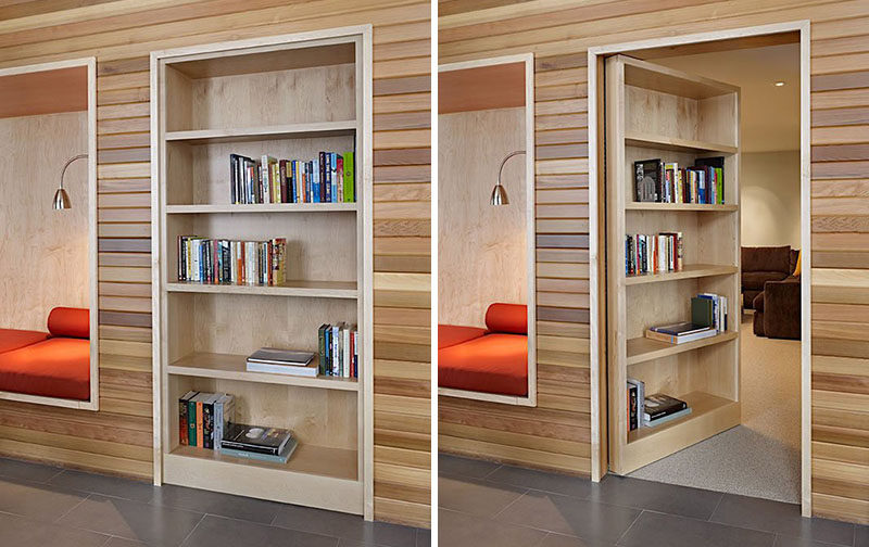 The built-in wooden bookshelf in this modern office becomes a secret door that can be pushed open to reveal a quiet and cozy hidden reading room.