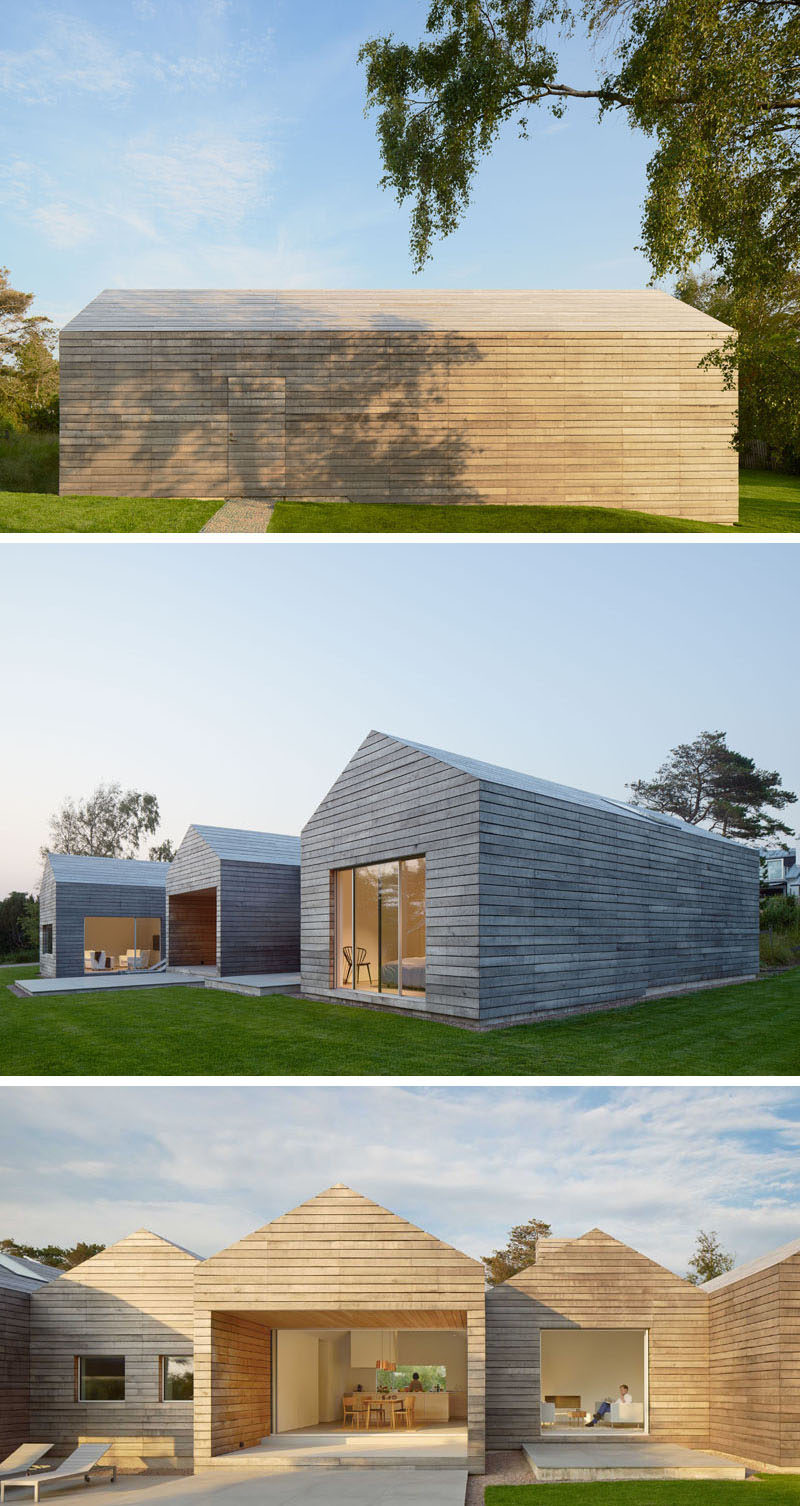 The design of this modern Swedish house, with its peaked roofs and horizontal wood plank siding, was inspired by the wood barns found in the surrounding area.
