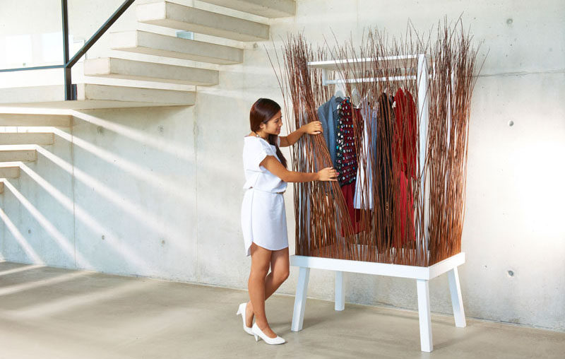 Paul Ketz has created a fun and unexpected design for a standalone closet (wardrobe), that uses willow branches to create the sides of the modern furniture piece.