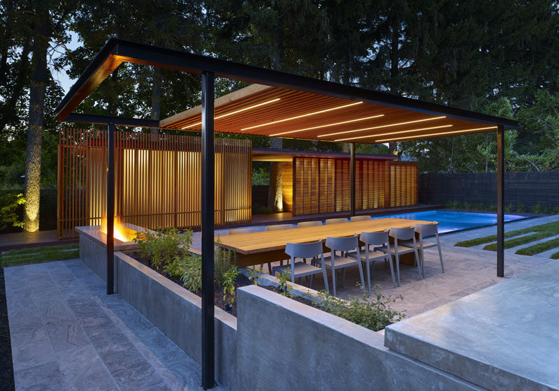 A Pool House Was Designed To Contain A Shower And Change Room For ...