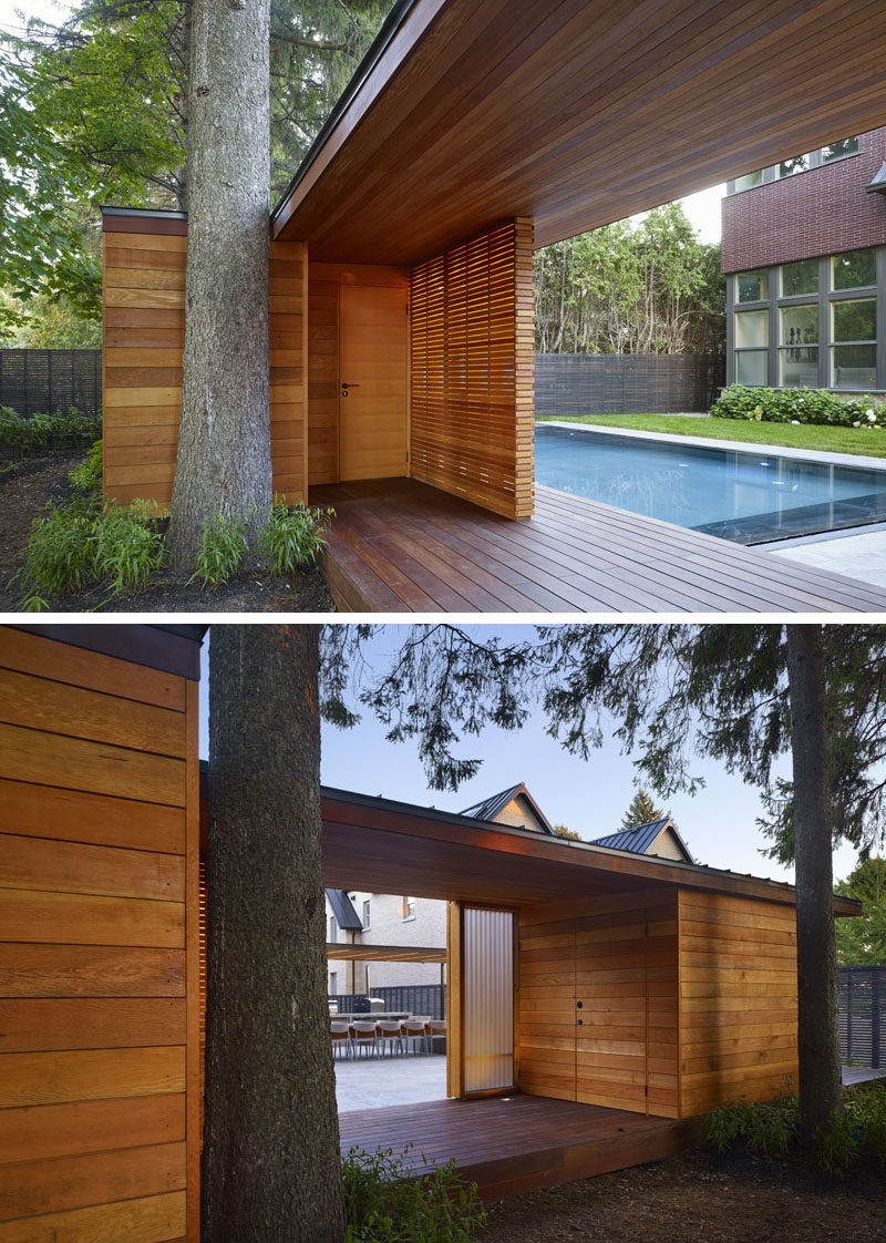 This modern pool house, which is mostly made from wood and sits at the end of the backyard, is the main focal point in the yard and hides the neighboring house. Slats of Douglas Fir screen the front of the pavilion and provide privacy for the interior spaces.