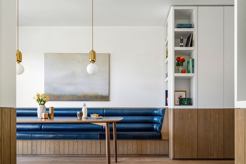 This dining area has a built-in banquette bench, inspired by Eileen Grey and her Bibendum Chair.