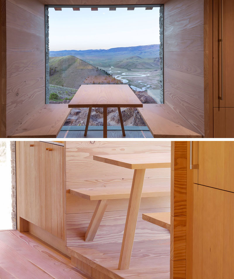 In this modern house, there's a built-in dining nook with benches that has a perfectly framed, unobstructed view.