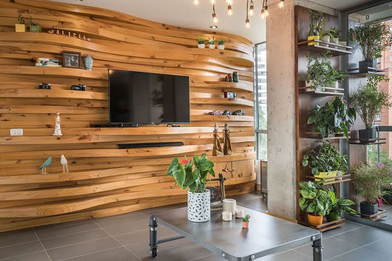 A Wavy Wood Accent Wall Creates Multiple Shelves In This Apartment
