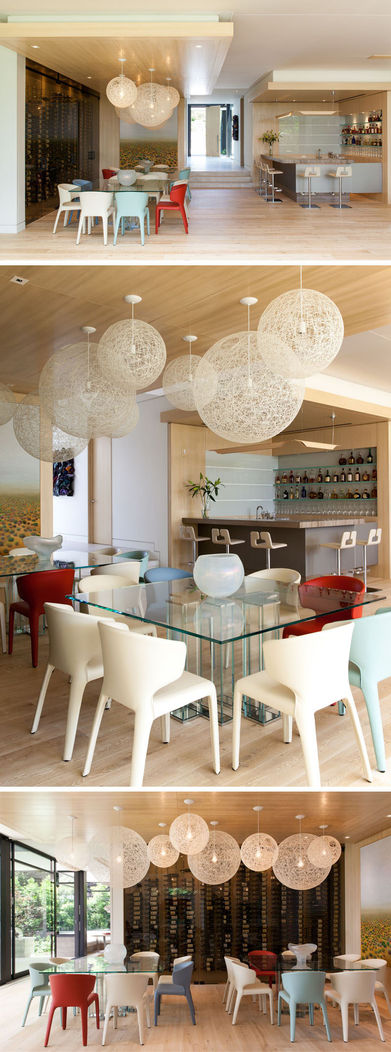 This modern house has a bar area and a dining area with two dining tables, perfect for entertaining large groups. There's also an entire wall dedicated to wine storage.