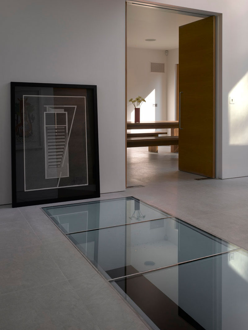 There's a glass panel or skylight in this floor that allows you to look down to the level below that's home to a pool.