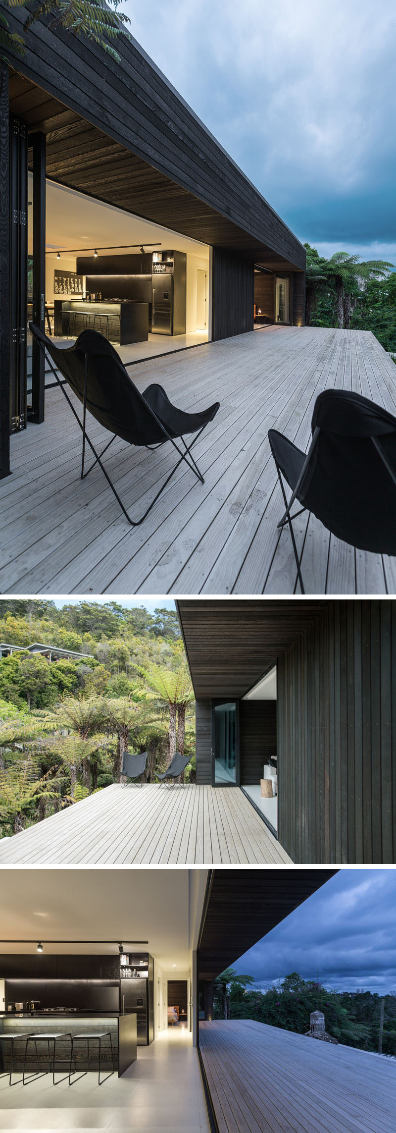 At the top of the stairs, the light wood steps expand out into a deck for this modern house, and glass bi-fold doors make the home perfect for indoor/outdoor living.
