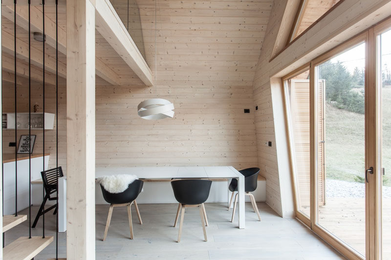In This Modern Light Wood And White Dining Room A Bench Is Built