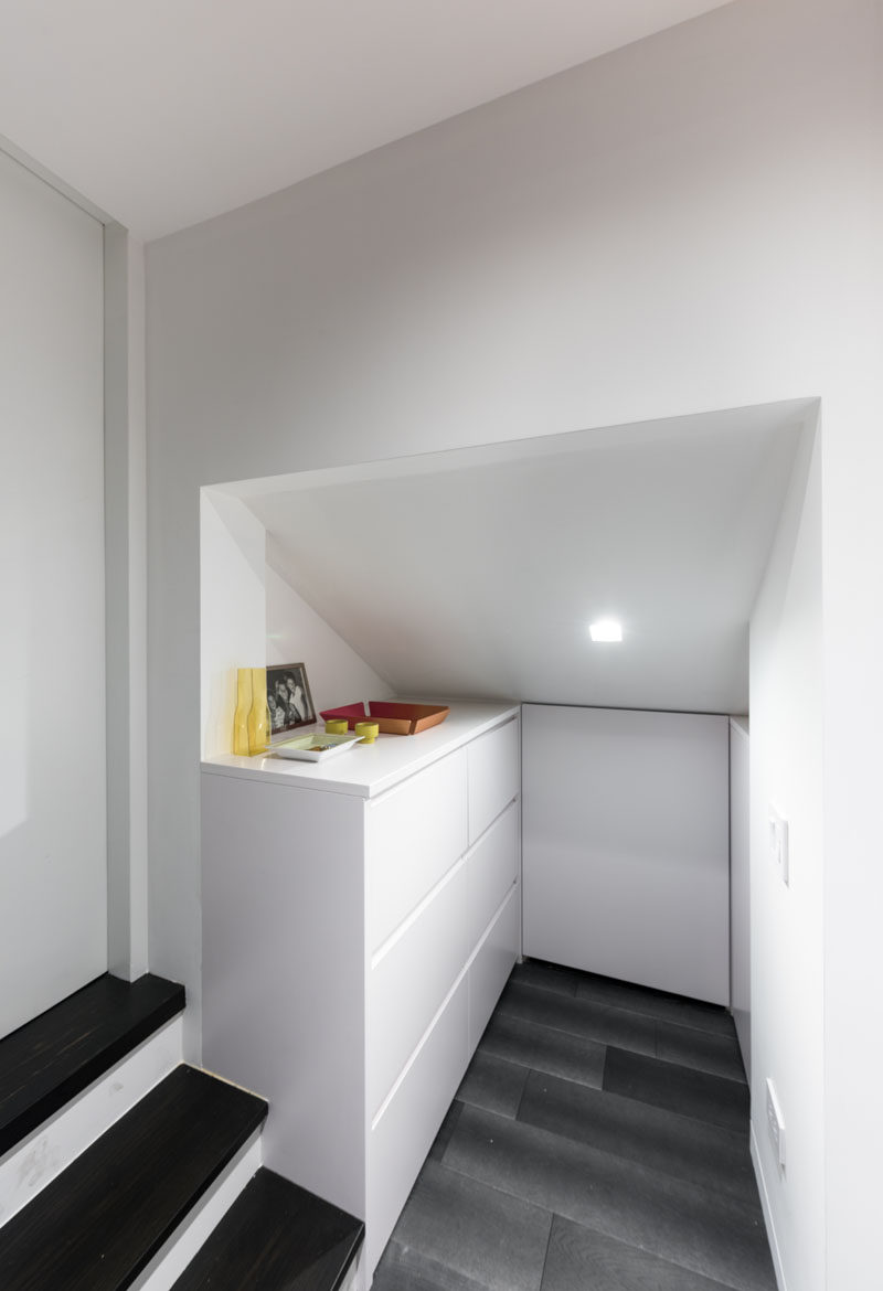 This micro apartment has a small entry space that houses a cabinet with storage, a must have item when designing such a small space.