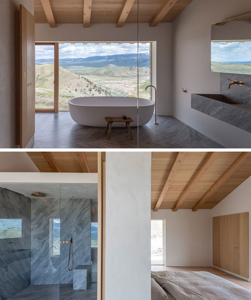 This master ensuite bathroom has a standalone white bathtub with a huge picture window so you can relax and take in the view. There's also a large walk-in shower gives you plenty of room to get clean.