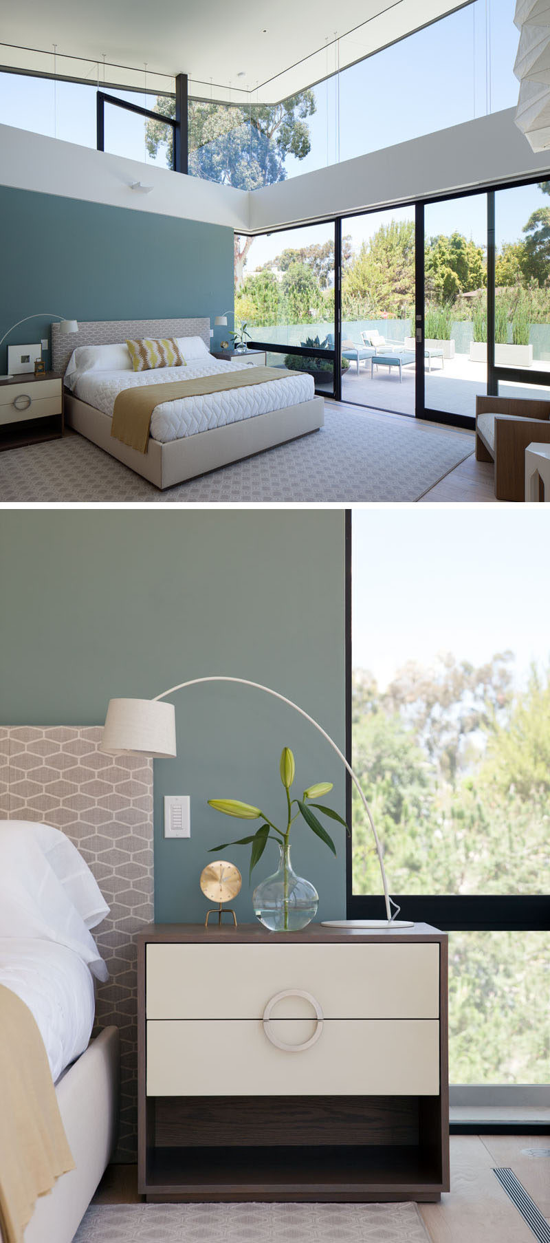 In this modern bedroom, a deep soft teal accent wall has been added for a touch of color, and sliding glass doors open to a private patio with views of the surrounding trees.