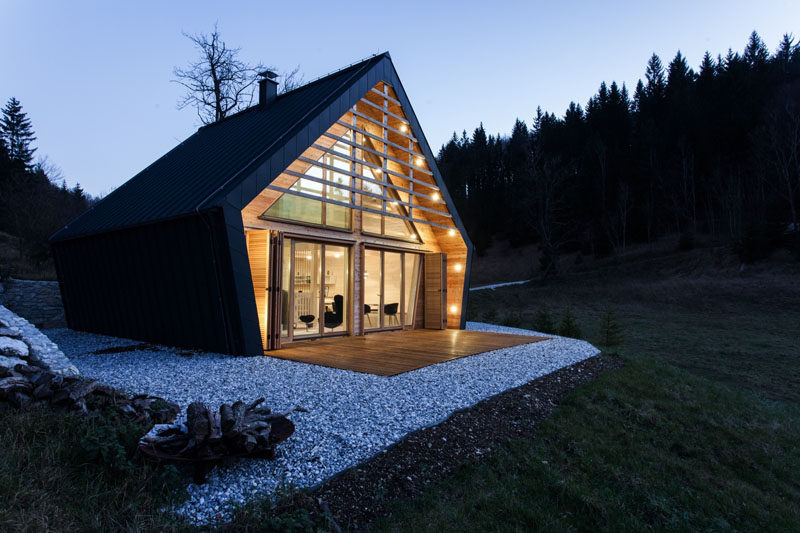 The Dark Exterior Of This Wood House Encloses A Light Interior