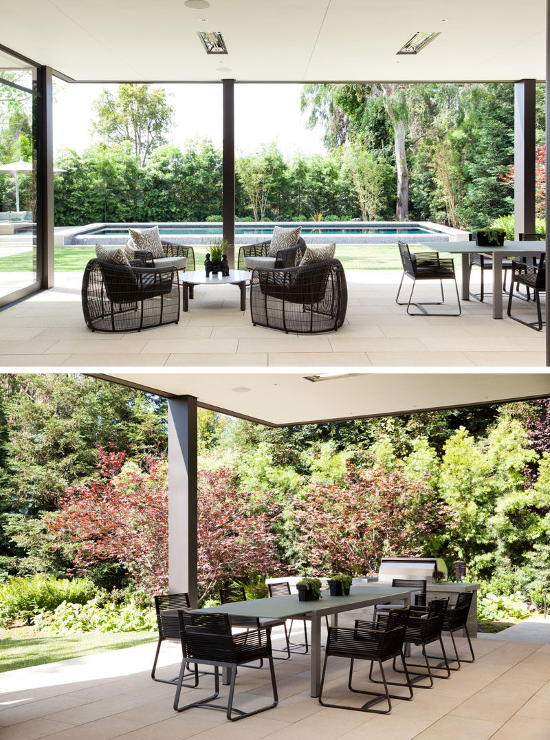 This modern house has a covered outdoor patio with a lounge and dining area with bbq, that opens up to a grassy backyard with a swimming pool.