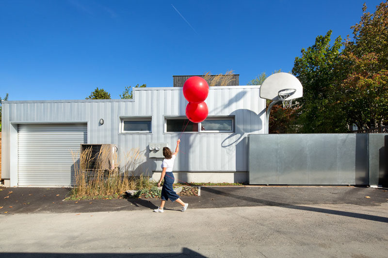 This modern garage has a small laneway house beside it.