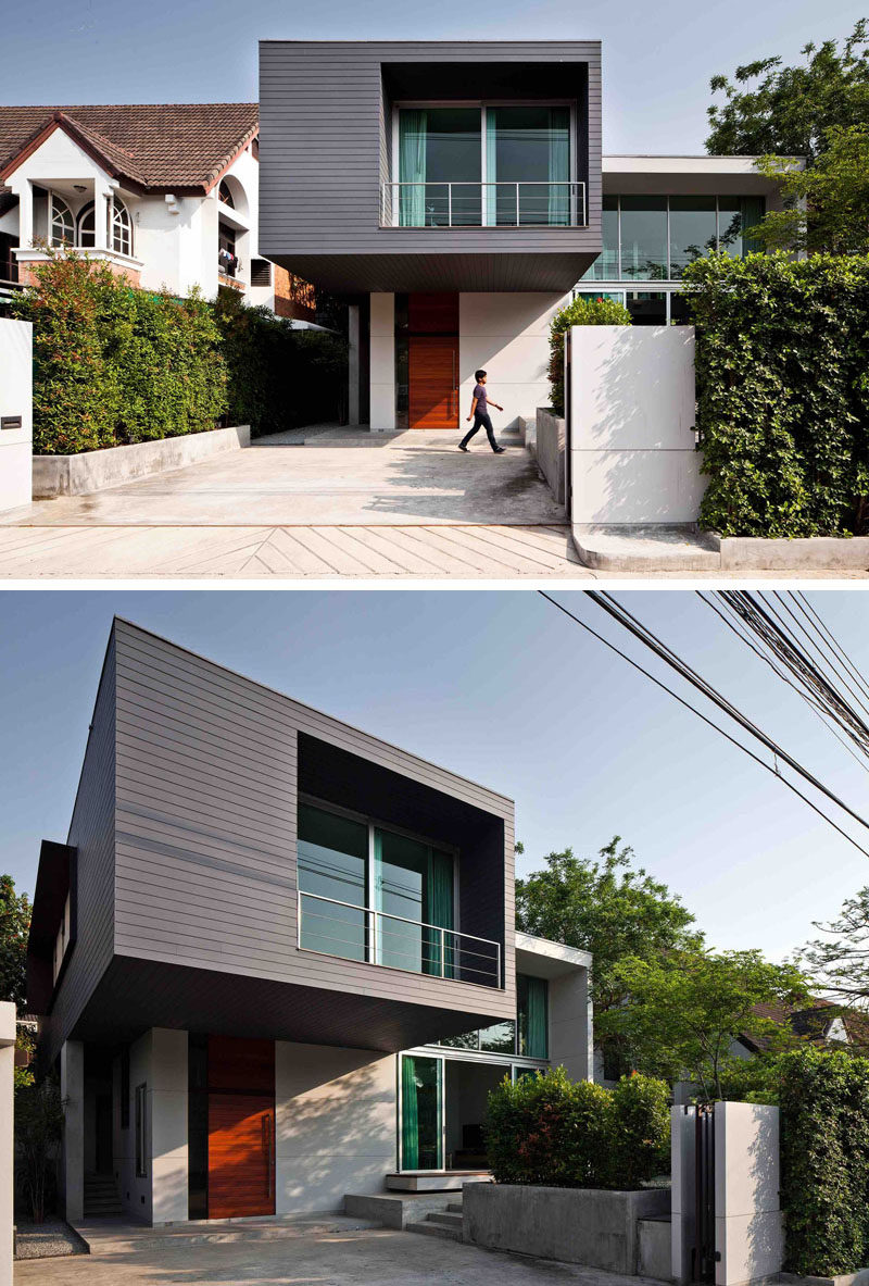 Lynk Architect have designed this two-storey modern house with a cantilevered bedroom, in the outskirts of Bangkok, Thailand, that sits beside an existing residence where the new owner's parents live.