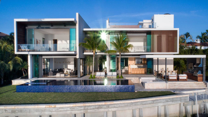 this modern house in miami has a swimming pool and an outdoor entertaining area with a - Modern Waterfront Home Designs