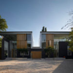 A Pair Of Houses With Tall Atriums Sit On This London Site