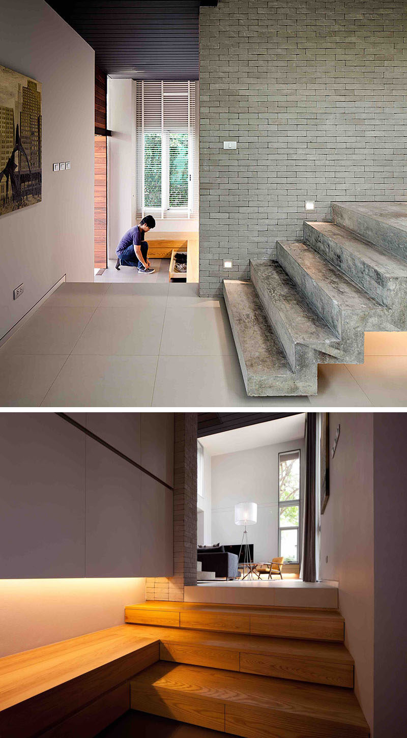 The foyer in this modern house has built-in storage drawers for hiding shoes.