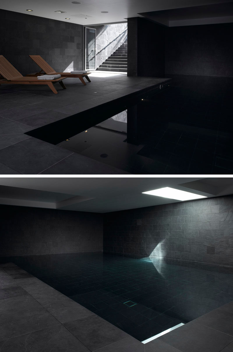 Hidden away in the lower level of this modern house is an indoor pool with dark grey slate tiles.