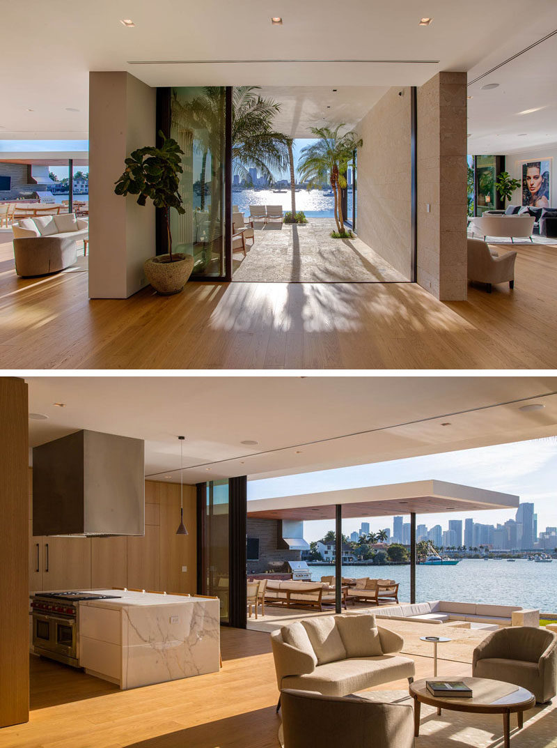 Inside the main floor of this modern house, the kitchen and a small sitting area are located to the left, while the living room is to the right