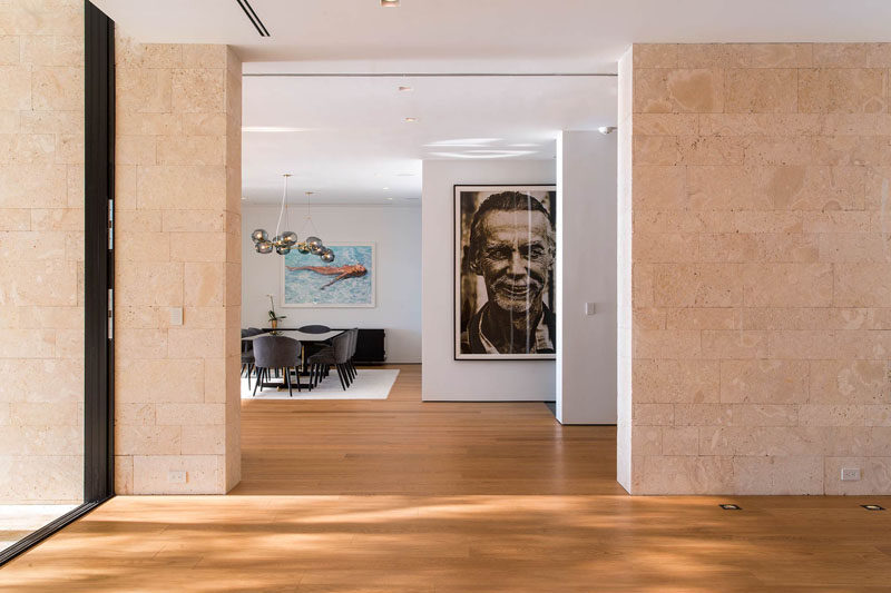 Large photos and artwork fill the otherwise bare walls in this modern house.