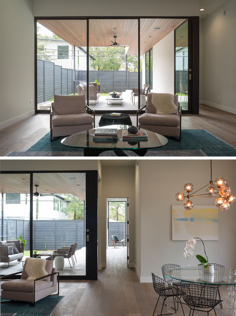A small covered outdoor space perfect for entertaining is located off the main living room in this modern house.